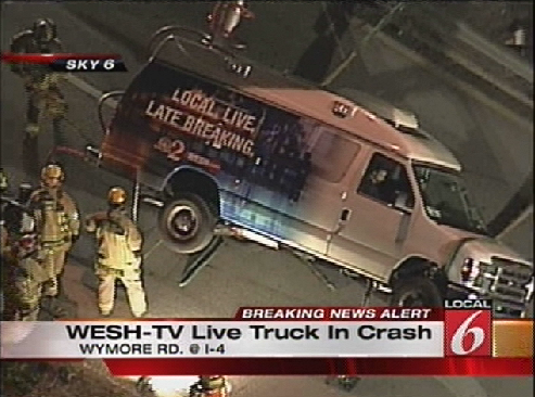 Firefighters attempt to stabilize the WESH 2 live truck before removing reporter Greg Fox and his photographer (Courtesy WKMG)